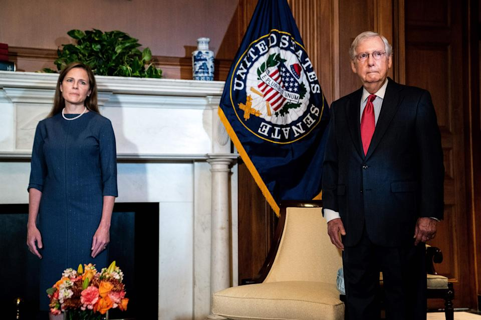 Mitch McConnell helped Judge Amy Coney Barrett avoid reporter questions when meeting on Capitol Hill on Tuesday (POOL/AFP via Getty Images)