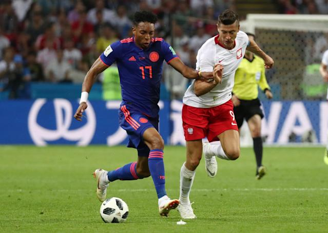 Soccer Football - World Cup - Group H - Poland vs Colombia - Kazan Arena, Kazan, Russia - June 24, 2018 Poland's Robert Lewandowski in action with Colombia's Johan Mojica REUTERS/Sergio Perez