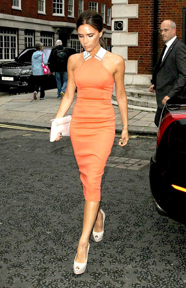 "Despite sporting her signature scowl, we adored the self-designed, tangerine-hued frock Victoria Beckham donned for pal Simon Fuller's birthday party in London earlier this week. The mom-of-four's posh accessories included a white clutch (from her collection, naturally), dark nail polish, and Giuseppe Zanotti leather platforms. (7/9/2012)<br><br><a target=""_blank"" href=""http://twitter.com/YahooOmg"">Follow omg! on Twitter!</a>"