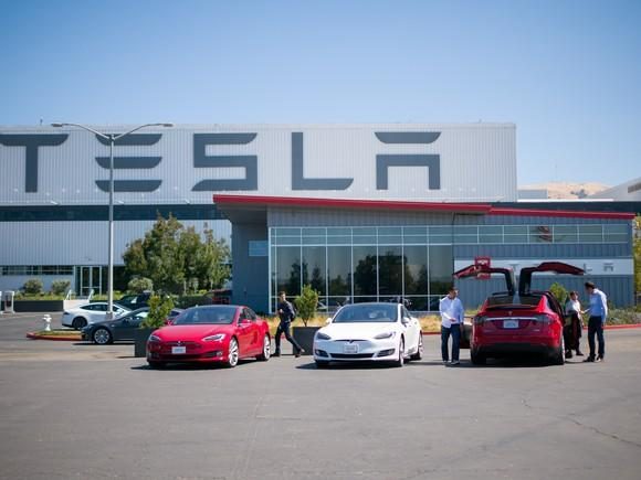 Tesla vehicles outside of the company's factory in Fremont, CA