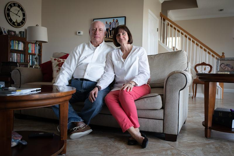 Jay and Gerri Gass, on the fifth anniversary of their daughter's death, pose for a portrait in their home in Ponte Vedra Beach, Fla. on March 18, 2019. Lara Gass died at age 27 in 2014 in a car crash caused by a faulty ignition switch.