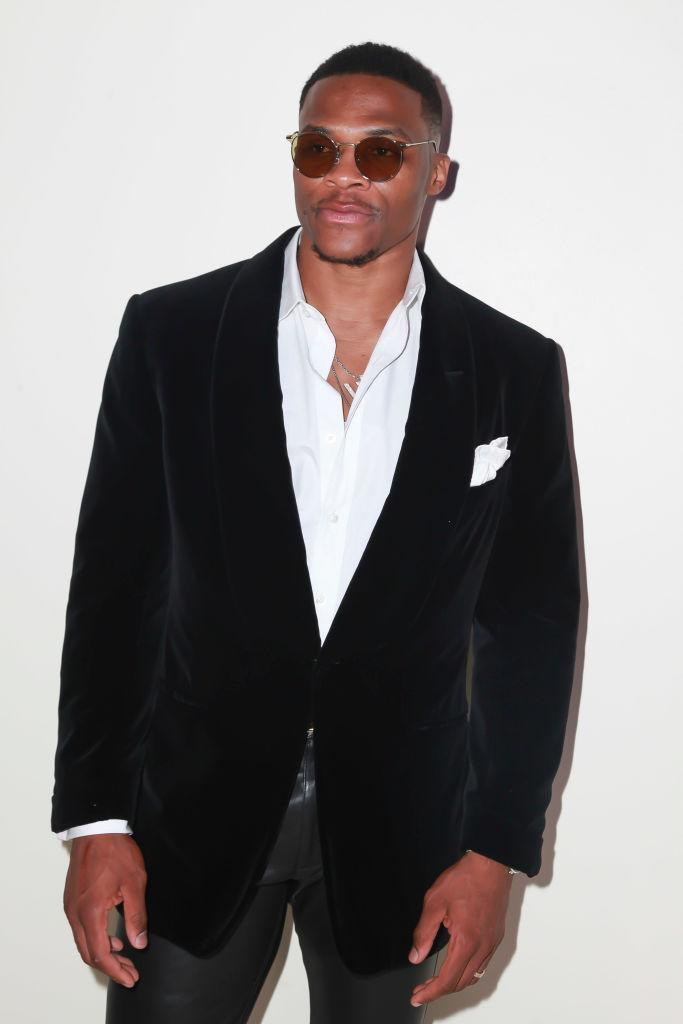 <p>Russell Westbrook attends Tom Ford's spring/summer 2019 fashion show wearing a black velvet cocktail jacket and classic white shirt on Sept. 5, 2018, in New York City. (Photo: Amber De Vos/Patrick McMullan via Getty Images) </p>