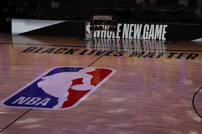 LAKE BUENA VISTA, FLORIDA - JULY 30: A general view the court with Black Lives Matter written above the NBA logo is seen at center court prior to the game between the LA Clippers and the Los Angeles Lakers at The Arena at ESPN Wide World Of Sports Complex on July 30, 2020 in Lake Buena Vista, Florida. NOTE TO USER: User expressly acknowledges and agrees that, by downloading and or using this photograph, User is consenting to the terms and conditions of the Getty Images License Agreement. (Photo by Mike Ehrmann/Getty Images)