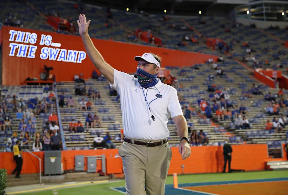 Florida coach Dan Mullen waves to the crowd before a game against Missouri at Ben Hill Griffin Stadium on Oct.31, 2020. (Alex de la Osa/Collegiate Images/Getty Images)