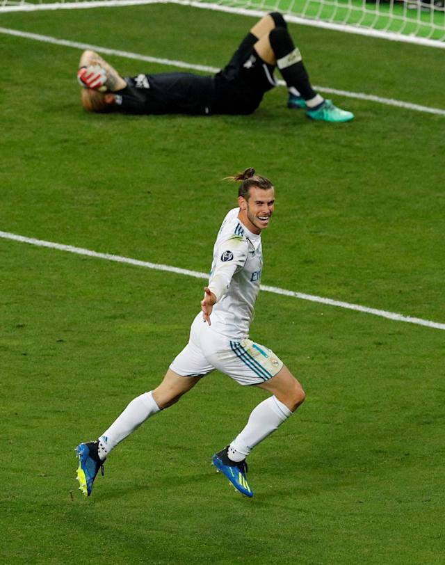 Soccer Football - Champions League Final - Real Madrid v Liverpool - NSC Olympic Stadium, Kiev, Ukraine - May 26, 2018 Real Madrid's Gareth Bale celebrates scoring their third goal as Liverpool's Loris Karius looks dejected REUTERS/Phil Noble TPX IMAGES OF THE DAY
