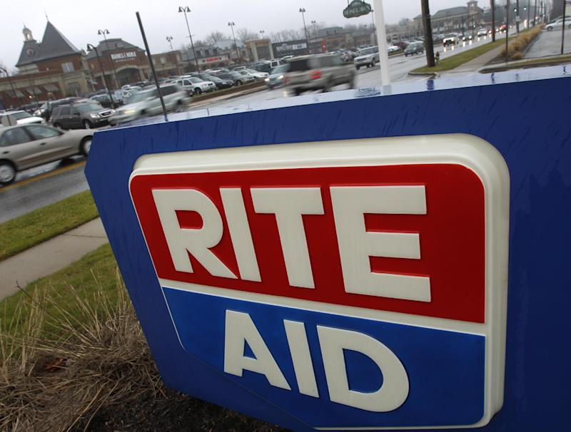 This Dec. 14, 2011 photo,  shows a a Rite Aid sign at a store in Woodmere, Ohio. Drugstore operator Rite Aid Corp. said Thursday, Dec. 15, 2011, it took a bigger loss in the third quarter despite improved sales. (AP Photo/Amy Sancetta)