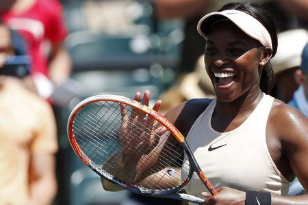 Mar 26, 2018; Key Biscayne, FL, USA; Sloane Stephens of the United States smiles at her player's box after her match against Garbine Muguruza of Spain (not pictured) on day seven of the Miami Open at Tennis Center at Crandon Park. Stephens won 6-3, 6-4. Mandatory Credit: Geoff Burke-USA TODAY Sports