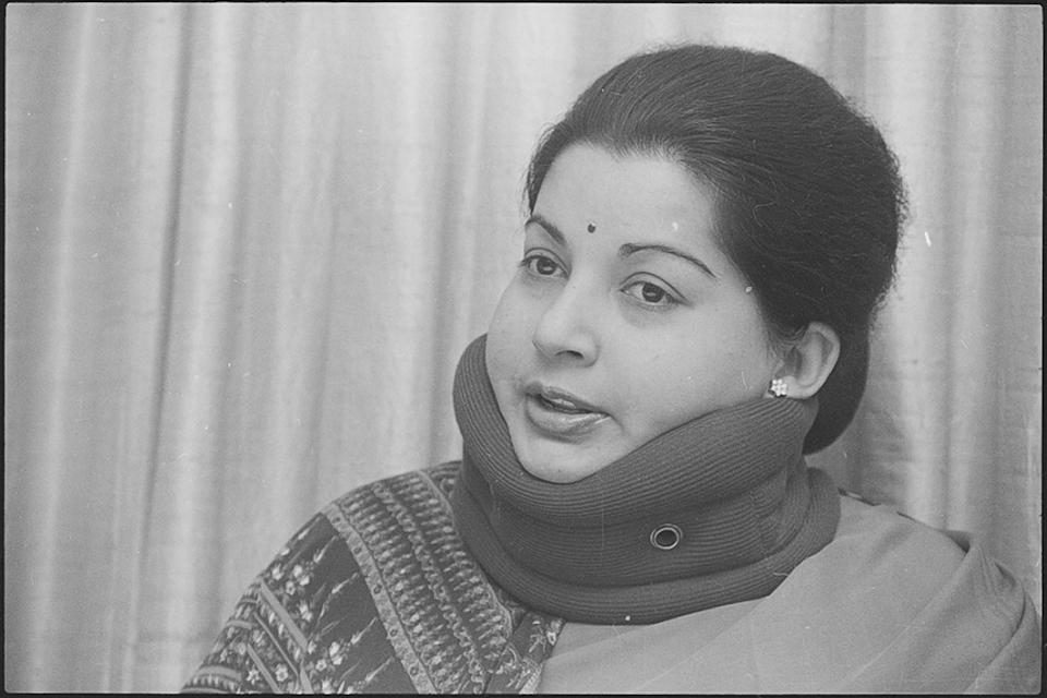 An actor-turned-politician, she served as the Chief Minister of Tamil Nadu for over fourteen years between 1991 and 2016. Her party, the AIADMK, revered her as their <em>Amma</em> (mother) and <em>Puratchi Thalaivi</em> (revolutionary leader). Her government was behind several social-welfare schemes, including those for subsidised <em>Amma</em>-branded goods such as canteens, bottled water and salt.