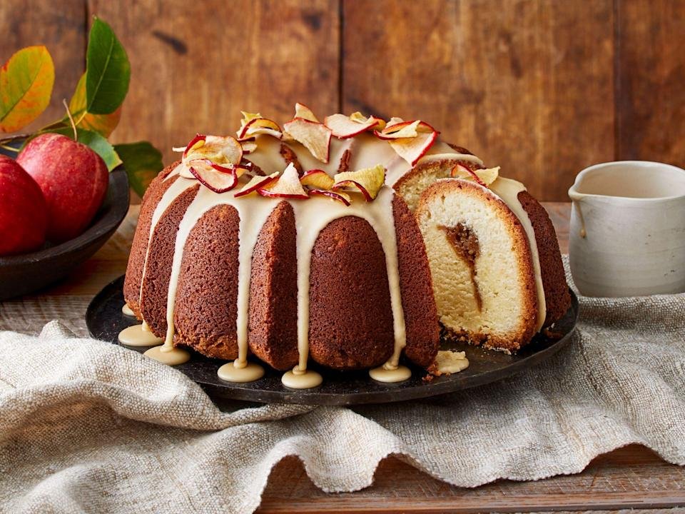 "<p><strong>Recipe: </strong><a href=""https://www.southernliving.com/recipes/apple-butter-pound-cake-caramel-frosting"" rel=""nofollow noopener"" target=""_blank"" data-ylk=""slk:Apple Butter Pound Cake with Caramel Frosting"" class=""link rapid-noclick-resp""><strong>Apple Butter Pound Cake with Caramel Frosting</strong></a></p> <p>Cut into this decadent pound cake to find a ribbon of homemade apple butter. A drizzle of homemade caramel frosting and a topping of crispy apple chips make for festive presentation worthy of a holiday dinner.</p>"