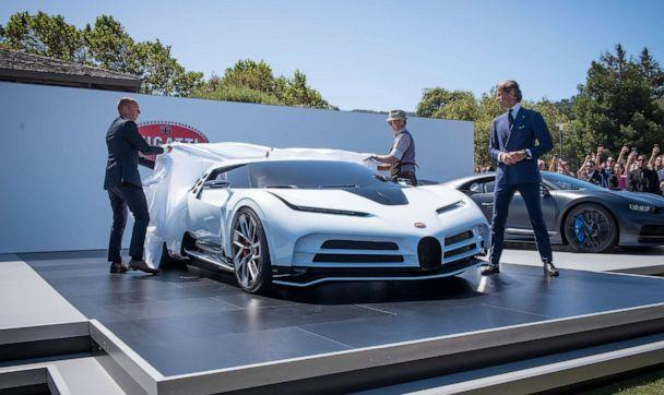 PHOTO: Stephan Winkelmann, president of Bugatti Automobiles SAS, right, watches the unveiling of the company's limited-edition Centodieci supercar in Carmel, Calif., Aug. 16, 2019. (Bloomberg via Getty Images)