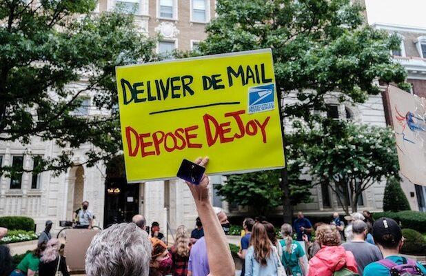 Protesters Stage 'Wake-Up Call' in Front of Postmaster General's House