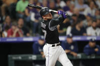 Colorado Rockies' Trevor Story watches his two-run home run off San Diego Padres starting pitcher Joey Lucchesi during the fourth inning of a baseball game Friday, Sept. 13, 2019, in Denver. (AP Photo/David Zalubowski)
