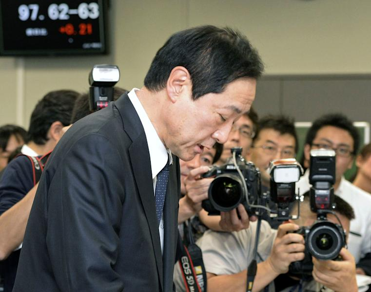 Mizuho Mizuho Financial Group President Yasuhiro Sato bows at the end of a press conference in Tokyo Monday, Oct. 28, 2013. Mizuho said Monday the chairman of its banking business and two other top executives will resign over the Japanese lender's failure to crack down on loans to organized crime. Mizuho said Sato will give up six months of pay but remain at his post. The bank also is appointing Tatsuo Kainaka, a former prosecutor and Supreme Court judge with a reputation for toughness, to be its chief compliance officer. (AP Photo/Kyodo News) JAPAN OUT, CREDIT MANDATORY
