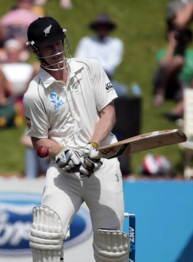 New Zealand's Jimmy Neesham gets hit by the ball during day one of the second international test cricket match against India at the Basin Reserve in Wellington, February 14, 2014. REUTERS/Anthony Phelps (NEW ZEALAND - Tags: SPORT CRICKET)