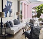 """<p>Nestled on the watery thoroughfare in Naples, a <a href=""""http://www.kembleinteriors.com/"""" rel=""""nofollow noopener"""" target=""""_blank"""" data-ylk=""""slk:Celerie Kemble"""" class=""""link rapid-noclick-resp"""">Celerie Kemble</a>-designed home flawlessly interacts with its lush, tropical setting with its open-air porch and enormous glass pocket doors. The conch shell pink exterior plays down the architecture's imposing British Colonial qualities. The sunroom's slipper chair and pillow fabric are by <a href=""""https://www.pennymorrison.com/"""" rel=""""nofollow noopener"""" target=""""_blank"""" data-ylk=""""slk:Penny Morrison"""" class=""""link rapid-noclick-resp"""">Penny Morrison</a> and <a href=""""https://www.delecuona.com/"""" rel=""""nofollow noopener"""" target=""""_blank"""" data-ylk=""""slk:de Le Cuona"""" class=""""link rapid-noclick-resp"""">de Le Cuona</a>. </p><p><a class=""""link rapid-noclick-resp"""" href=""""https://www.veranda.com/home-decorators/a32166023/celerie-kemble-naples-florida-house-tour/"""" rel=""""nofollow noopener"""" target=""""_blank"""" data-ylk=""""slk:Tour the Home"""">Tour the Home</a></p>"""