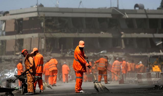 <p>Afghan Municipality workers sweep a road in front of the German Embassy after a suicide attack in Kabul, Afghanistan, Wednesday, May 31, 2017. (AP Photos/Rahmat Gul) </p>