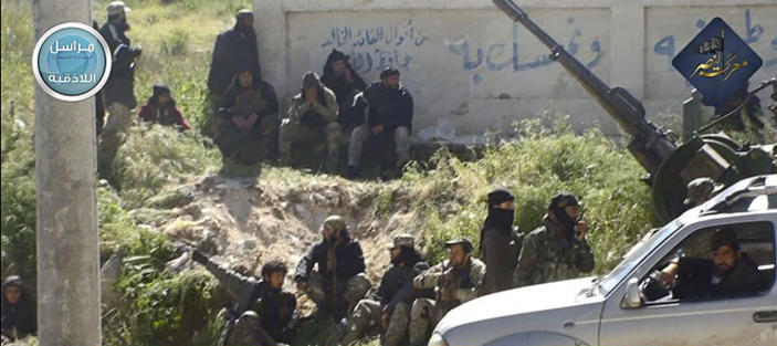 FILE - In this file photo posted on the Twitter page of Syria's al-Qaida-linked Nusra Front on April 25, 2015, which is consistent with AP reporting, shows Nusra Front fighters in the town of Jisr al-Shughour, Idlib province, Syria. Turkey and Russia appear to have succeeded in creating a demilitarized zone along the frontlines of Syria's flashpoint Idlib region, after rebels and an al-Qaida-linked alliance pulled back their heavy weaponry in accordance with the agreement. (Al-Nusra Front Twitter page via AP, File)
