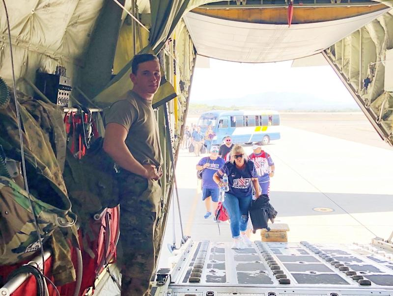 Team USA members of the Americas Women's Bowl board a C-130 sent by President Trump to bring them home from Honduras as the coronavirus pandemic broke out across the world. (Courtesy of AFE)