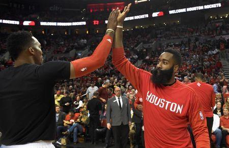 Feb 25, 2016; Portland, OR, USA; Houston Rockets center Dwight Howard (12) high fives Houston Rockets guard James Harden (13) before the game against the Portland Trail Blazers at the Moda Center at the Rose Quarter. Mandatory Credit: Steve Dykes-USA TODAY Sports