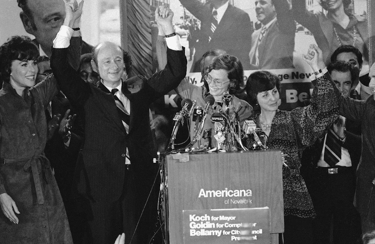 "FILE - In this Nov. 8, 1977, file photo, Rep. Ed Koch, second from left, celebrates in New York with Bess Myerson, left, Carol Bellamy, center Diana Goldin, second from right, and her husband Harrison Goldin after being elected as New York's mayor. Ed Koch, right, as they leave New York's Grand Central after holding a news conference for the ""Committee to Save Grand Central Station."" Koch, the combative politician who rescued the city from near-financial ruin during three City Hall terms, has died at age 88. Spokesman George Arzt says Koch died Friday morning Feb. 1, 2013 of congestive heart failure. (AP Photo/Ray Stubblebine, File)"