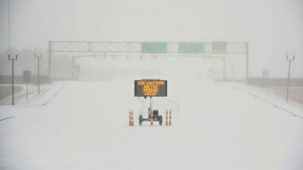PHOTO: A sign warns motorists after a sudden heavy bout of snow and frozen rain on MS Highway 463 in Madison, north of Jackson, Miss., Feb. 15, 2021. (Barbara Gauntt/clarion-ledger/via Reuters)
