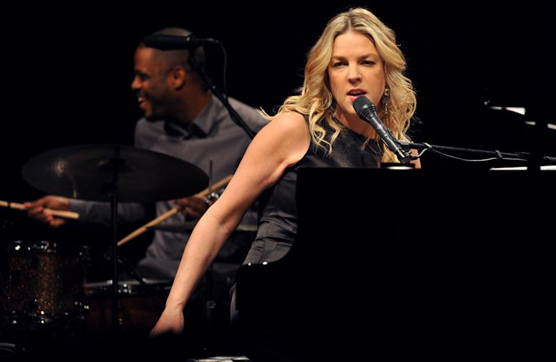 "FILE - In this Nov. 20, 2009 file photo, Canadian jazz pianist and singer Diana Krall performs in Universal Hall in Macedonia's capital Skopje. Krall played the standard ""Fly Me to the Moon"" during a concert at the Hollywood Bowl in Los Angeles, Saturday, Aug. 25, 2012, in honor of astronaut Neil Armstrong, who died earlier in the day. (AP Photo/Boris Grdanoski, File)"