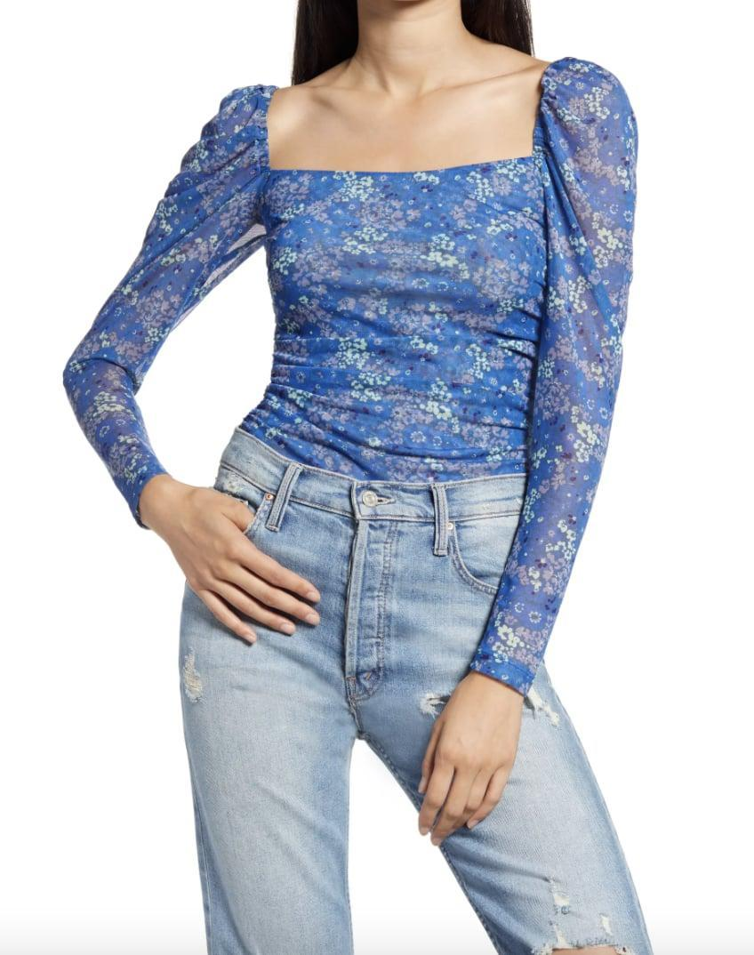 <p>The colorful print of this <span>Lost Ink Heart Pattern Tie Waist Blouse</span> ($19, originally $49) makes it so fresh.</p>