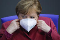 German Chancellor Angela Merkel adjusts her face mask as she arrives for a speech about German government's policies to combat the spread of the coronavirus and COVID-19 disease at the parliament Bundestag, in Berlin, Germany, Thursday, Oct. 29, 2020. (Photo/Markus Schreiber)