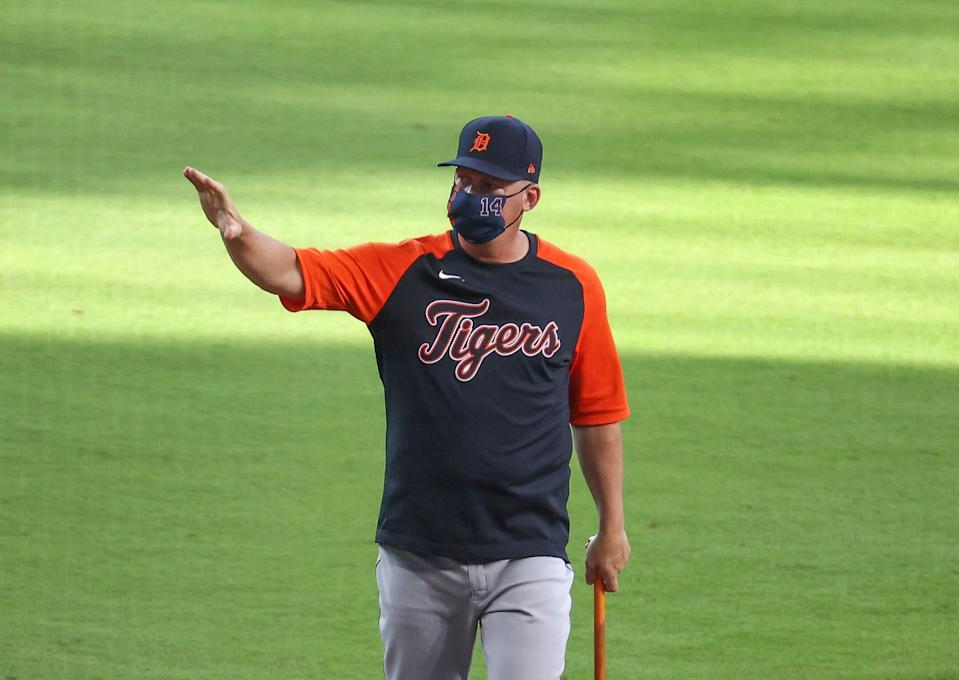 Detroit Tigers manager A.J. Hinch (14) waves before a game against the Houston Astros at Minute Maid Park.