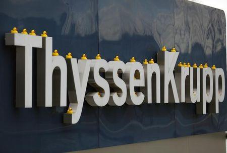 Toy ducks are placed on a sign of Germany's top steelmaker ThyssenKrupp during a protest at their headquarters in Essen
