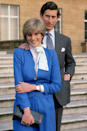 <p>Di's royal blue skirt suit, worn for the announcement of her engagement to Prince Charles, famously matched her sapphire engagement ring. Our favourite detail, though? The polished pussybow blouse, tied to the side.</p>