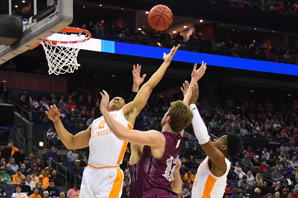 <p>Grant Williams #2 and Lamonte Turner #1 of the Tennessee Volunteers try to grab a rebound from Dana Batt #12 of the Colgate Raiders in the first round of the 2019 NCAA Men's Basketball Tournament held at Nationwide Arena on March 22, 2019 in Columbus, Ohio. (Photo by Jamie Schwaberow/NCAA Photos via Getty Images) </p>