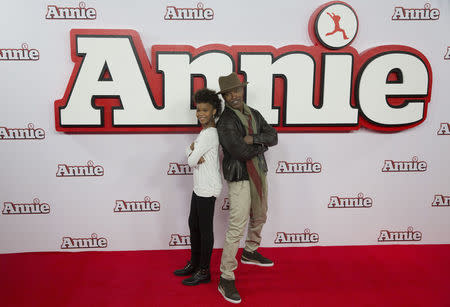 Actor Jamie Foxx, and actress Quvenzhane Wallis pose for photographers during a photocall for their film Annie, in central London December 16, 2014.  REUTERS/Neil Hall