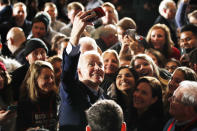 Democratic presidential candidate former Vice President Joe Biden walks in the crowd at a caucus night campaign rally on Monday, Feb. 3, 2020, in Des Moines, Iowa. (AP Photo/John Locher)
