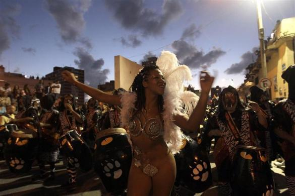 Members of a comparsa, an Uruguayan carnival band, plays the drums to perform candombe music and dance during the first night of the Llamadas parade in Montevideo February 9, 2012.