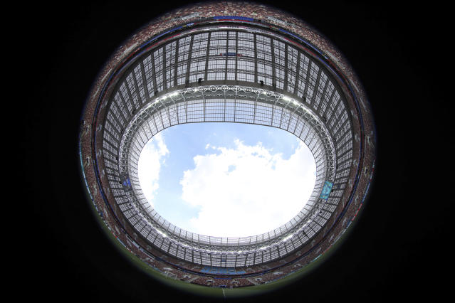 General view, made with a fish-eye, ahead of the training of France at the eve of the group C match between France and Denmark at the 2018 soccer World Cup in the Luzhniki Stadium in Moscow, Russia, Monday, June 25, 2018. (AP Photo/David Vincent)