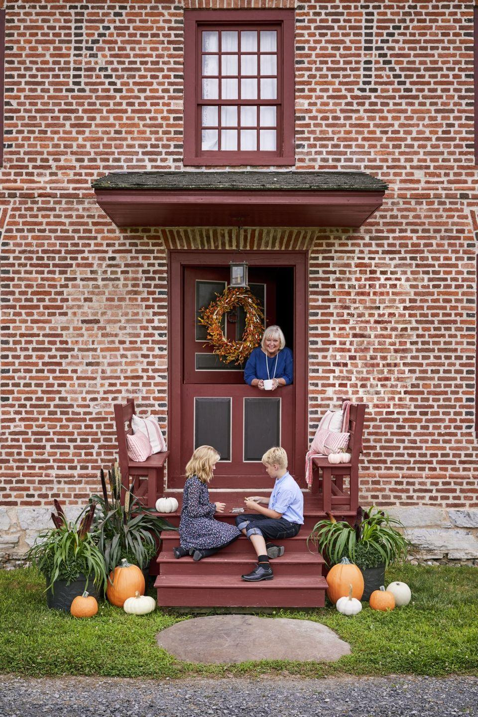 """<p>A deep red hue looks flawless against a brick home, evoking an old schoolhouse feel.</p><p><a class=""""link rapid-noclick-resp"""" href=""""https://store.benjaminmoore.com/storefront/color-samples/paint-color-samples-1-pint/prodPRM01A.html?sbcColor=PM_15"""" rel=""""nofollow noopener"""" target=""""_blank"""" data-ylk=""""slk:SHOP COTTAGE RED BY BENJAMIN MOORE"""">SHOP COTTAGE RED BY BENJAMIN MOORE</a></p>"""