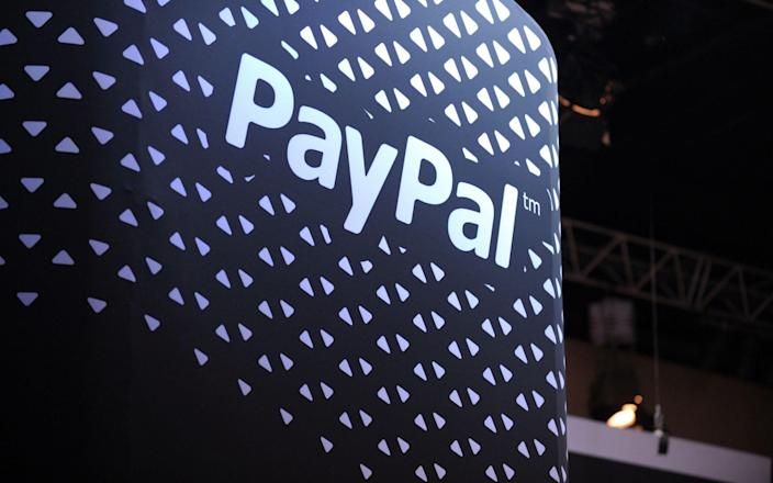 The payments giant has launched a new buy now, pay later scheme in Britain - Eric Piermont/AFP