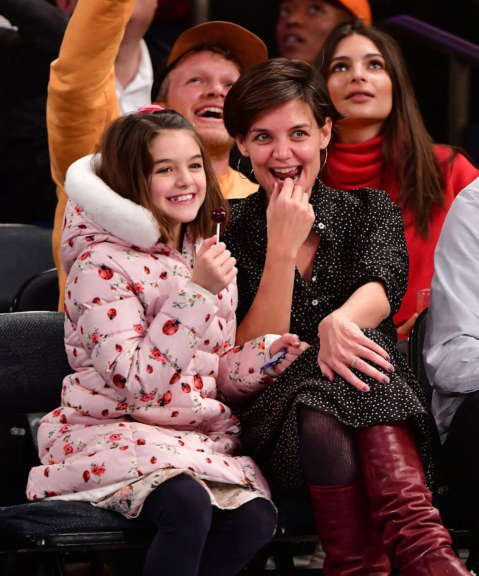 Suri Cruise and Katie Holmes attend an NBA game in 2017. (Photo: James Devaney via Getty Images)