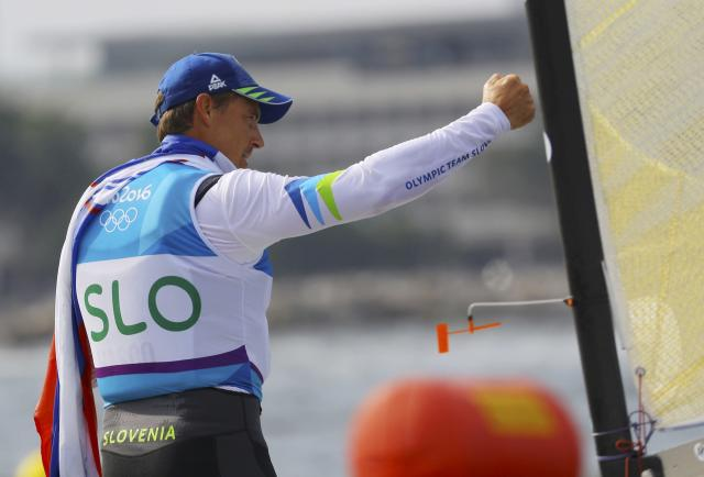 2016 Rio Olympics - Sailing - Final - Men's One Person Dinghy (Heavyweight) - Finn - Medal Race - Marina de Gloria - Rio de Janeiro, Brazil - 16/08/2016. Vasilij Zbogar (SLO) of Slovenia celebrates silver medal. REUTERS/Brian Snyder FOR EDITORIAL USE ONLY. NOT FOR SALE FOR MARKETING OR ADVERTISING CAMPAIGNS.