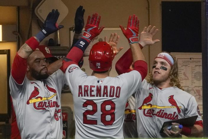 St. Louis Cardinals' Nolan Arenado hits a home run during the third inning of a baseball game against the Milwaukee Brewers Friday, Sept. 3, 2021, in Milwaukee. (AP Photo/Morry Gash)