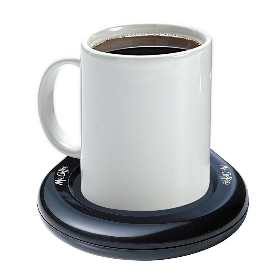 """<p>Place any drink on the <a href=""""https://www.popsugar.com/buy/Mr-Coffee-Mug-Warmer-30529?p_name=Mr.%20Coffee%20Mug%20Warmer&retailer=amazon.com&pid=30529&price=9&evar1=savvy%3Aus&evar9=41791804&evar98=https%3A%2F%2Fwww.popsugar.com%2Fsmart-living%2Fphoto-gallery%2F41791804%2Fimage%2F41792558%2FMr-Coffee-Mug-Warmer&list1=shopping%2Cgifts%2Camazon%2Choliday%2Cwellness%2Cgift%20guide%2Cconsumerism%2Cgifts%20under%20%24100%2Cgifts%20under%20%2450%2Cgifts%20under%20%2475%2Cgifts%20under%20%24200&prop13=mobile&pdata=1"""" rel=""""nofollow"""" data-shoppable-link=""""1"""" target=""""_blank"""" class=""""ga-track"""" data-ga-category=""""Related"""" data-ga-label=""""https://www.amazon.com/Mr-Coffee-MWBLK-Mug-Warmer/dp/B000CO89T8?ie=UTF8&amp;tag=14606-20"""" data-ga-action=""""In-Line Links"""">Mr. Coffee Mug Warmer</a> ($9) and keep it hot for hours. </p>"""