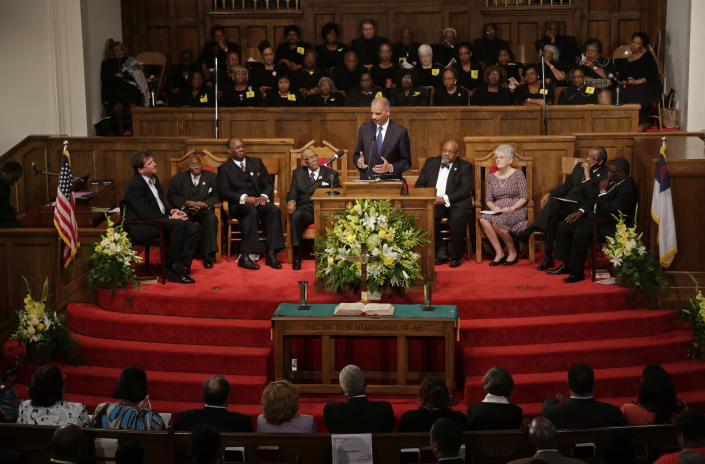 U.S. Attorney General Eric Holder addresses the congregation at the 16th Street Baptist Church in Birmingham, Ala., Sunday, Sept. 15, 2013. The church held a ceremony honoring the memory of the four young girls who were killed by a bomb placed outside the church 50 years ago by members of the Ku Klux Klan. (AP Photo/Dave Martin)