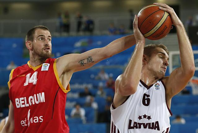 Belgium's Sacha Massot, left, fights for a ball with Latvia's Rolands Freimanis, right, during their EuroBasket European Basketball Championship Group E match in Ljubljana, Slovenia, Sunday, Sept. 15, 2013. (AP Photo/Petr David Josek)
