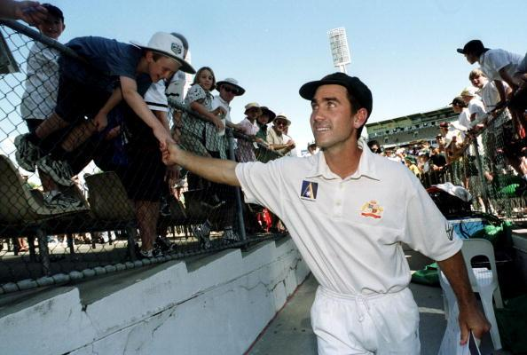 28 Nov 1999: Australia's Justin Langer, named Player of the Series is congratulated by a young fan as he leaves the WACA grond, following Australia's  3 - 0 series win over Pakistan on day three of the third test played between Australia and Pakistan atthe WACA ground in Perth, Western Australia, Australia.  Mandatory Credit: Jack Atley/ALLSPORT