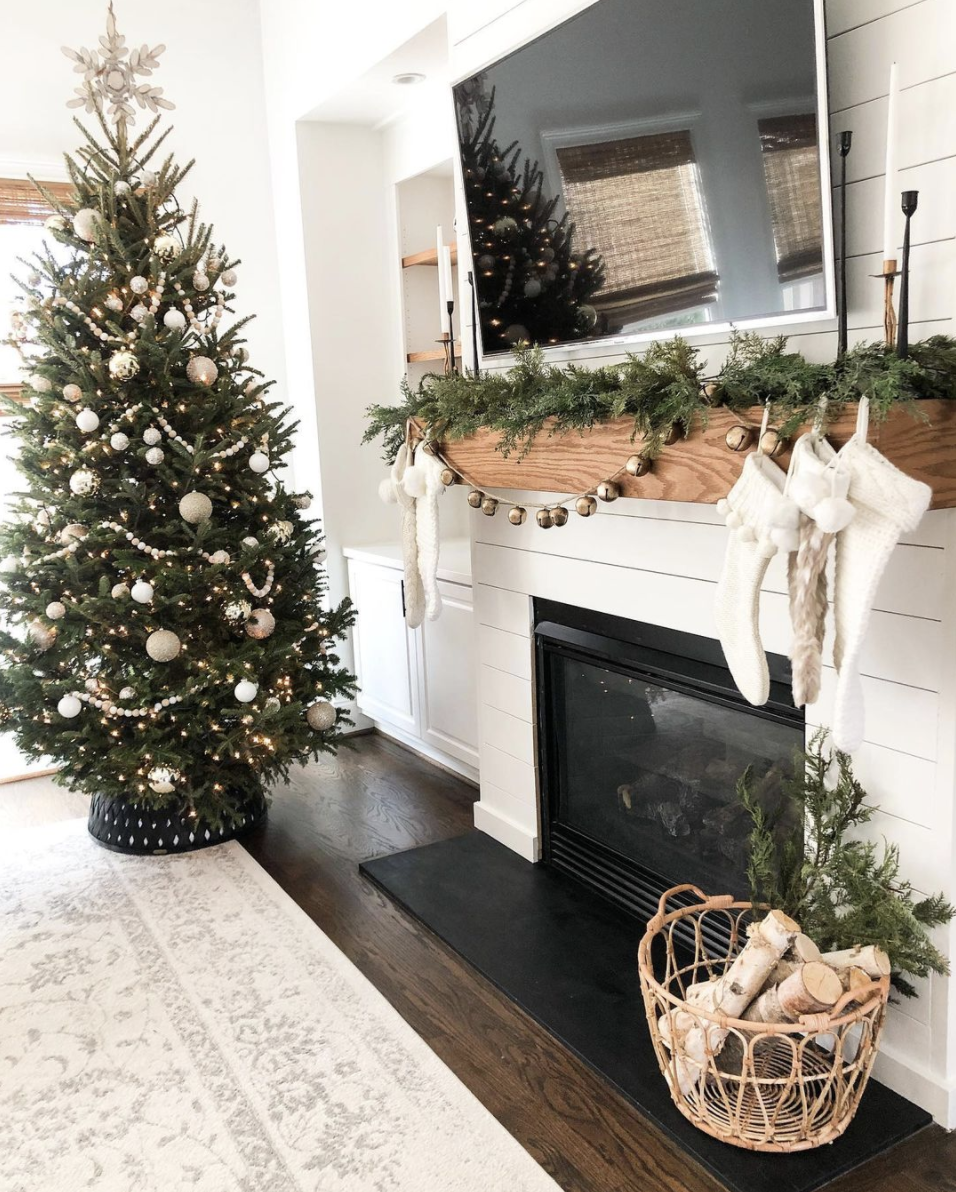"<p>When you have a TV above your mantle, you don't want anything that might disrupt the picture, which is why we love the idea of a strand of jingle bells. They add plenty of festive flair, but won't reflect onto the screen. </p><p><em>See more at <a href=""https://www.instagram.com/p/B6DmfDYF7yT/"" rel=""nofollow noopener"" target=""_blank"" data-ylk=""slk:neely.alyse"" class=""link rapid-noclick-resp"">neely.alyse</a>.</em></p><p><a class=""link rapid-noclick-resp"" href=""https://www.amazon.com/Rastogi-Handicrafts-Decorative-Vintage-Hanging/dp/B0185DYDJC?tag=syn-yahoo-20&ascsubtag=%5Bartid%7C10072.g.34484299%5Bsrc%7Cyahoo-us"" rel=""nofollow noopener"" target=""_blank"" data-ylk=""slk:SHOP BELL GARLAND"">SHOP BELL GARLAND</a></p>"