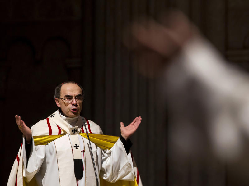 FILE - In this April 3, 2016 file photo, French Cardinal Philippe Barbarin, Archbishop of Lyon, leads a mass for migrants in the Saint-Jean Cathedral, in Lyon, central France. The Roman Catholic Church faces another public reckoning when a French cardinal goes on trial Monday, Jan. 7, 2019 for his alleged failure to report a pedophile priest who confessed to preying on Boy Scouts and whose victims want to hold one of France's highest church figures accountable. (AP Photo/Laurent Cipriani, File)