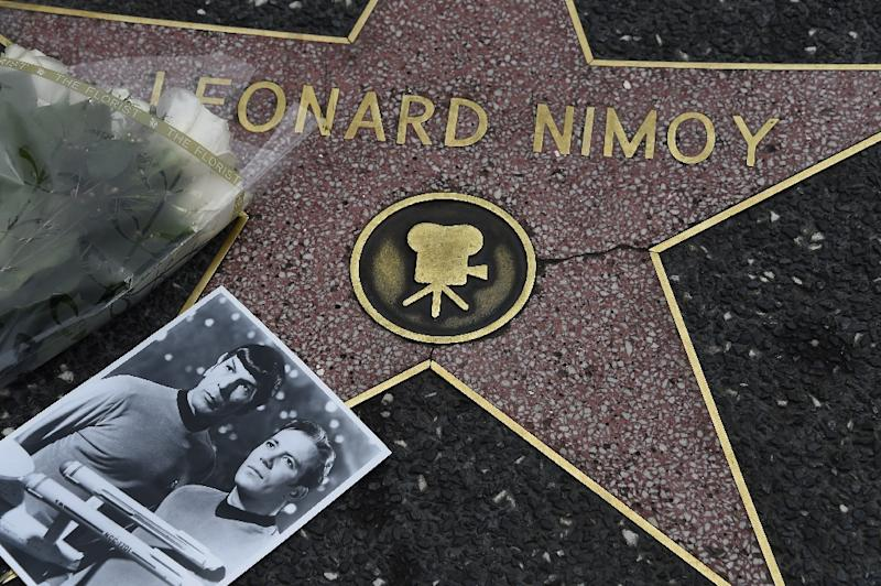 Flowers and a photo are placed on the star of actor Leonard Nimoy on February 27, 2015 on the Hollywood Walk of Fame (AFP Photo/Robyn Beck)