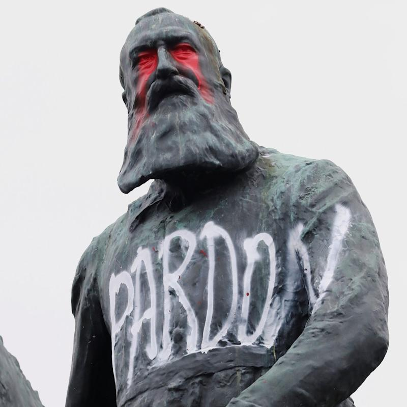 The vandalised statue of Leopold II outside the royal palace close to the centre of Brussels. - Reuters