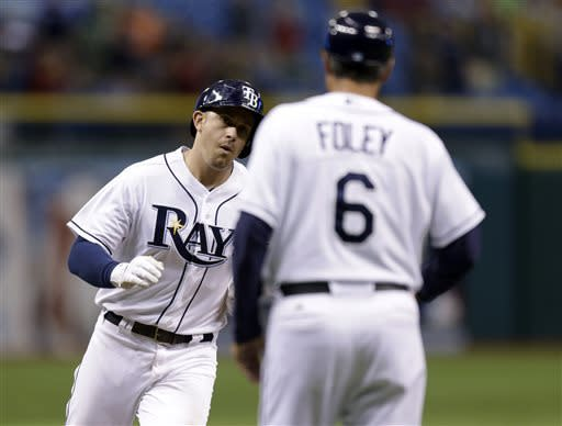 Tampa Bay Rays' Evan Longoria, left, high fives third base coach Tom Foley after hitting a ninth-inning home run off New York Yankees relief pitcher Mariano Rivera during a baseball game Tuesday, April 23, 2013, in St. Petersburg, Fla. (AP Photo/Chris O'Meara)